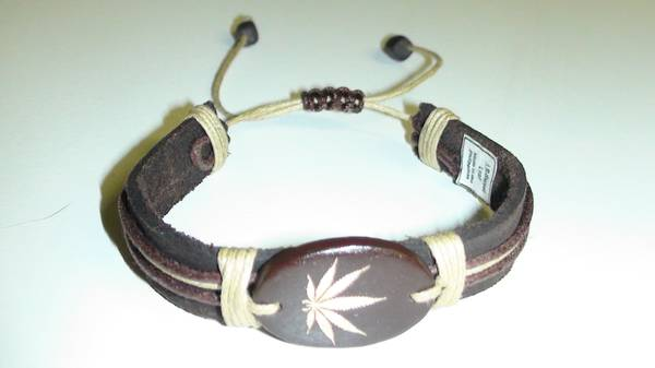 Leather Surfer Bracelet Featuring a Coconut Pendant Etched with a Gold Cannabis Leaf